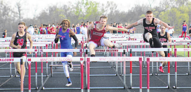 Minford senior Drew Skaggs (second from right) captured the championship of the boys 110m high hurdles as part of Friday night's Minford Invitational track and field meet.