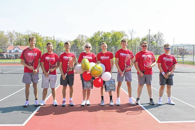 The Minford boys tennis team honored seniors Teegan Clarkson (center left) and Sam Wiehle (center right) prior to their match versus Portsmouth West on Tuesday.