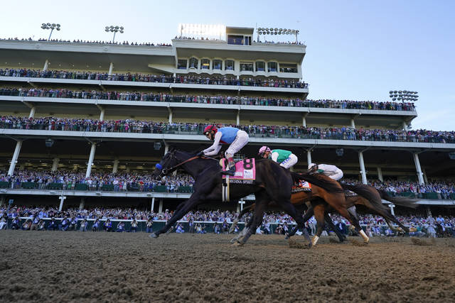 John Velazquez riding Medina Spirit leads Florent Geroux on Mandaloun and Flavien Prat riding Hot Rod Charlie to win the 147th running of the Kentucky Derby at Churchill Downs, Saturday, May 1, 2021, in Louisville, Ky. (AP Photo/Jeff Roberson)