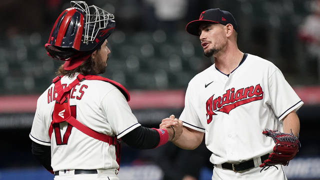 Cleveland Indians relief pitcher Nick Wittgren, right, is congratulated by catcher Austin Hedges after the Indians defeated the Cincinnati Reds 9-2 in a baseball game Saturday, May 8, 2021, in Cleveland. (AP Photo/Tony Dejak)