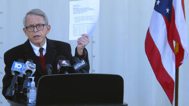 FILE - In this Nov. 18, 2020 file photo, Republican Ohio Gov. Mike DeWine discusses the most recent data on Ohio's soaring coronavirus cases during a news briefing at John Glenn International Airport in Columbus, Ohio. DeWine is ready to address Ohioans in his fourth primetime speech about the state's progress against the coronavirus pandemic. DeWine planned his address for late Wednesday, May 12, 2021. (AP Photo/Andrew Welsh-Huggins)