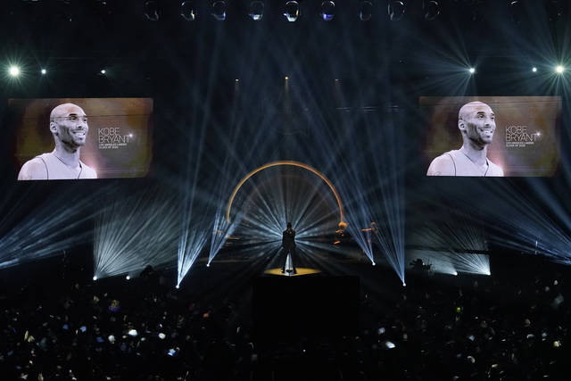 """The late Kobe Bryant is honored, as are others who have died, as Ne-Yo sings """"Incredible"""" during the 2020 Basketball Hall of Fame enshrinement ceremony Saturday, May 15, 2021, in Uncasville, Conn. (AP Photo/Kathy Willens)"""