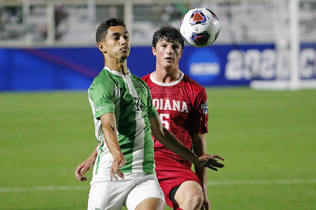 Marshall's Vitor Dias (31) battles with Indiana's Daniel Munie (5) during the first half of the NCAA College Cup championship soccer match in Cary, N.C., Monday, May 17, 2021. (AP Photo/Karl B DeBlaker)