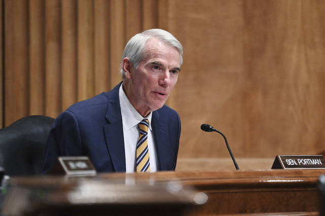 FILE - In this May 13, 2021, file photo, Rob Portman, R-Ohio, speaks during a Senate Homeland Security and Governmental Affairs Committee on unaccompanied minors at the southern border, on Capitol Hill in Washington. Portman announced earlier this year that he would not run again. The Senate primary in Ohio is still a year away, but Republican contenders already are working furiously to cast themselves as Trump's favorite in the open race. (Mandel Ngan/Pool via AP, File)