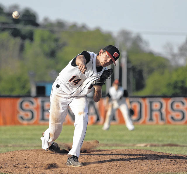 West senior Luke Bradford (14) delivers a pitch to a Coal Grove batter during Wednesday's Division III baseball sectional semifinal game at West High School.
