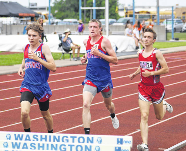 Northwest junior Kailan Marshall (left), Northwest senior Landen Smith (center) and Minford senior Dutch Byrd (right) finished fifth, second and fourth respectively in the boys 3,200m run.
