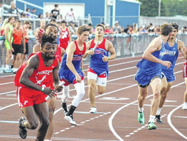 Northwest's Brayden Campbell (back) hands off to teammate Mason Breech (front) as the Mohawks qualified for Saturday's finals in the boys 4x400m relay.