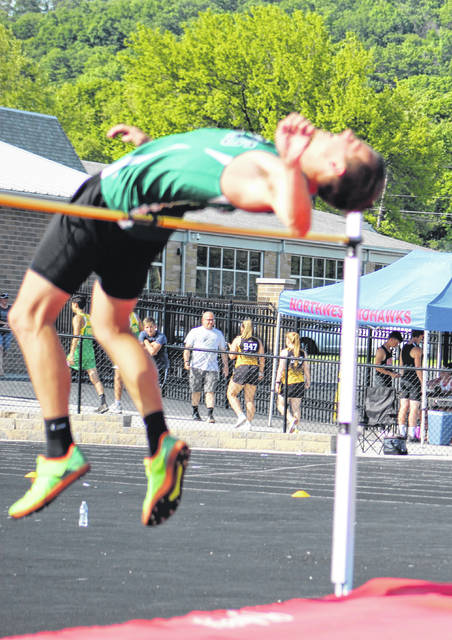 Green senior Ethan Huffman captured the championship of the boys high jump as part of Friday's Southeast District Division III track and field meet at Northwest High School.