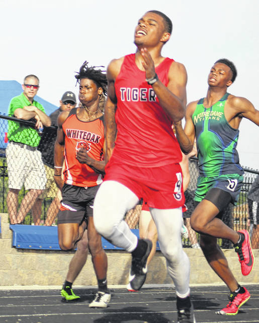 New Boston senior De'Von Jones (front) qualified for Friday's finals in the boys 100m and 200m dashes as part of Wednesday's Day 1 of 2 of the Region 11 meet at Southeastern High School.