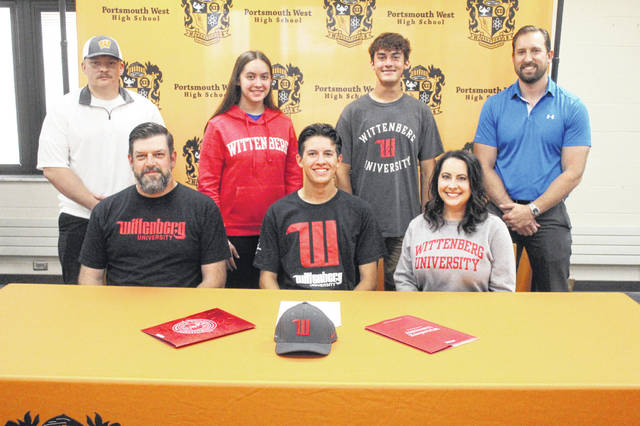 Portsmouth West senior Caleb Hazelbaker (center seated) signed to continue his education and soccer career at Wittenberg University in a recent signing ceremony held inside the PWHS library. Pictured (L-R, front row): Craig Hazelbaker, Caleb Hazelbaker, Meleah Hazelbaker. (L-R, backrow): Coach Daniel Thompson, Abigail Hazelbaker, Ethan Hazelbaker, Ben Johnson