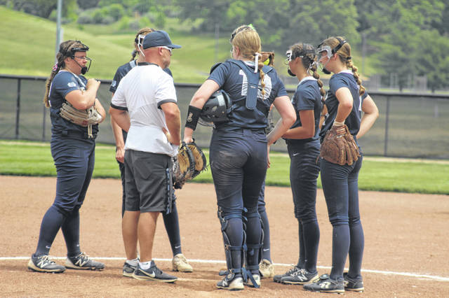 A late mound meeting between Notre Dame coach J.D. McKenzie and his Lady Titans came with South Webster threatening with two runners on and no outs in the top of the 7th inning of their Division IV district championship win over the Lady Jeeps.
