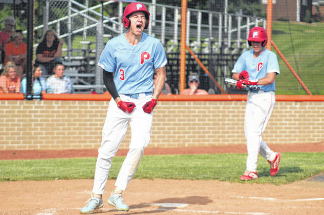 Portsmouth junior Daewin Spence (3) shows emotion after his game-tying solo home run in the top of the 4th inning of the Trojans' district semifinal versus Wheelersburg.