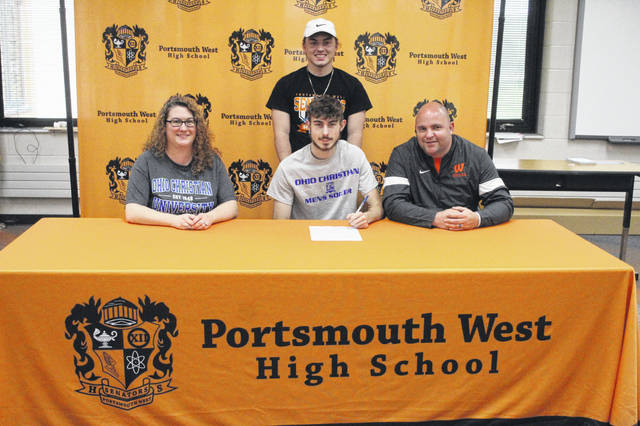 Portsmouth West senior Maverick Stone (center seated) signed to continue his education and join the men's soccer team at Ohio Christian University. Pictured (L-R) Christina Montgomery, Maverick Stone, Riely Carr (standing), Bryan Craft.