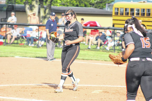 Wheelersburg freshman AndiJo Howard (32) smiles at the ball in her glove after recording a lineout catch from her pitcher's position in the Lady Pirates' 13-6 win over Tusky Valley in a Division III regional semifinal.