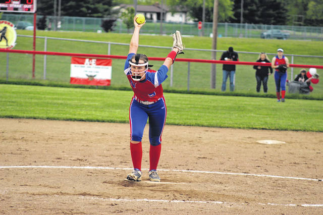Northwest senior Lexi Throckmorton (9) delivers a pitch during the Lady Mohawks' 6-5 win over Minford in SOC II play.