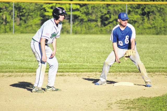 Green senior Levi Singleton (left) and East junior second baseman Kevin Billings (right) play near the bag during their meeting in Southern Ohio Conference Division I play on Wednesday.