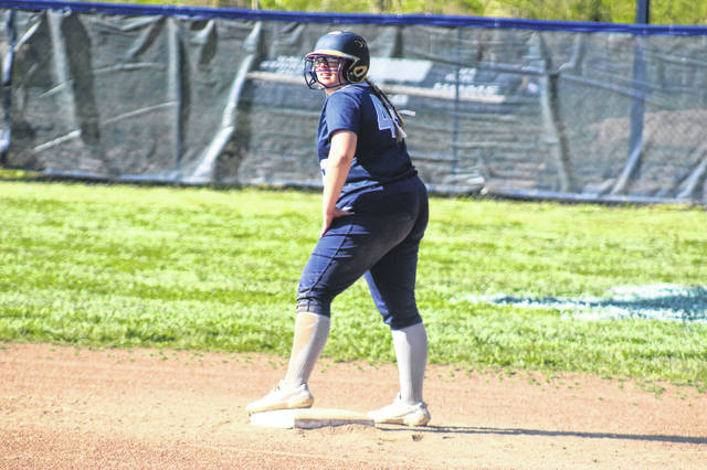 Notre Dame senior Madison Suter (43) stands at second after her two RBI single during the second inning of the Lady Titans' 19-0 win over Whiteoak in a Division IV sectional final.