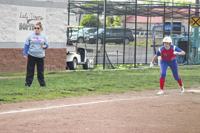 Northwest sophomore Alyssa Ferguson stands on third base near head coach Lora West (left) during the Lady Mohawks' 9-6 loss to Portsmouth in a Division III sectional final.