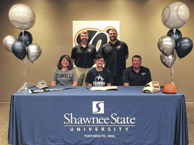 Wheelersburg High School senior Mason Montgomery, seated center, announces his intention to play college baseball at Shawnee State University. Seated with Montgomery are mother Amy Montgomery (left) and father Stacy Montgomery (right). Standing are Wheelersburg High School assistant baseball coach Andy Heimbach (left) and Wheelersburg High School head baseball coach Derek Moore (right).