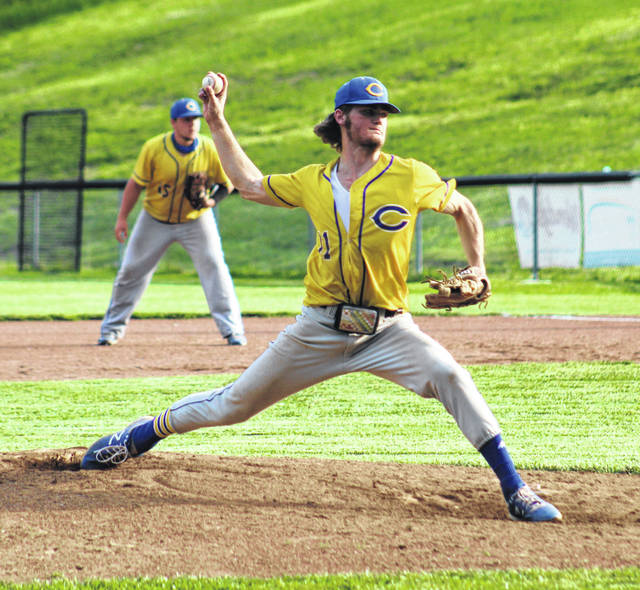 Clay senior Shaden Malone delivers a pitch to a Peebles batter during Tuesday's Division IV baseball sectional championship game at Clay High School.