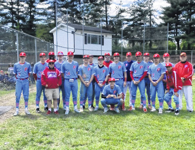 The Portsmouth Trojans baseball team celebrate following their 10-0 win over Coal Grove in OVC play — one in which junior pitcher Daewin Spence threw a five inning perfect game.