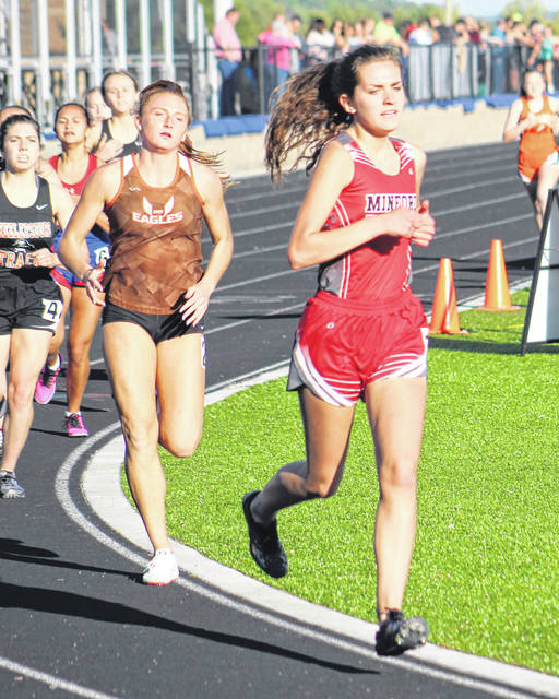 Minford's Junie Allen leads Eastern's Abby Cochenour and Wheelersburg's Amanda Salmons in the girls 1,600m run as part of Thursday's Southern Ohio Conference track and field meet at Northwest High School's Roy Rogers Field. Allen was the runner-up in the 1,600m run and captured the championship of the 800m and 3,200m runs.