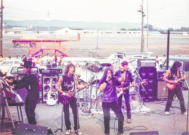 """Members of the 1980's """"WIZARD"""" band have spred out to varying parts of the country in the years since, but have stayed in touch. On Friday, the rock group will perform again as the Final Friday headliner."""