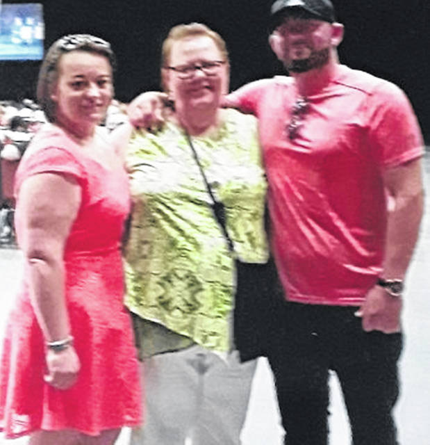 Amanda Lennex Rickett and Richard Lennex with their mother, Garnet Adams, who works with the Salvation Army,