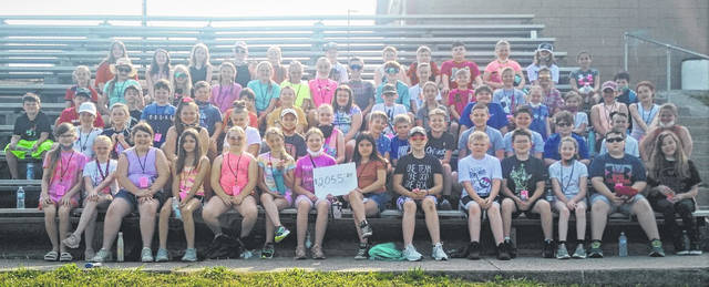Minford 4th graders raised $2.055.20 for the Bear Hug Effect. Part of the collection was a walkathon they participated in on the high school track.