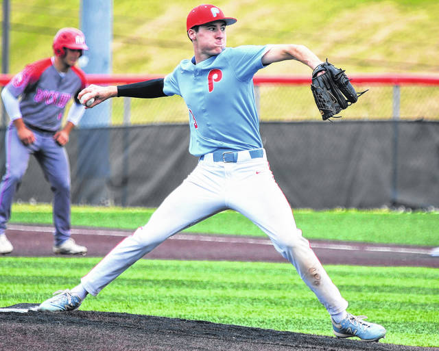 Portsmouth junior Daewin Spence, shown here pitching in the Trojans' tournament game at Rock Hill, captured first-team all-Ohio Valley Conference baseball honors.