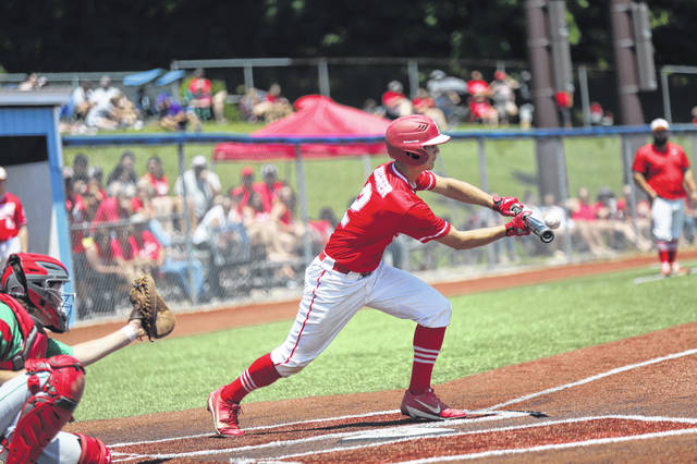Minford senior Matthew Risner (2) lays down an RBI bunt signle during the Falcons' 10-7 loss to Barnesville in a Division III, Region 11 Final at Beavers Field.