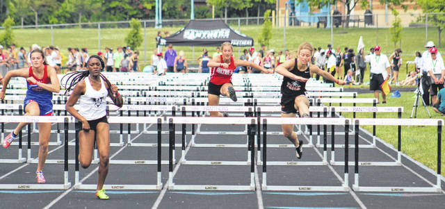 Northwest senior Haidyn Wamsley (left) and Wheelersburg senior Lauren Jolly (right) both qualified for Saturday's finals from Friday's semifinals in the girls Division II 100m hurdles.