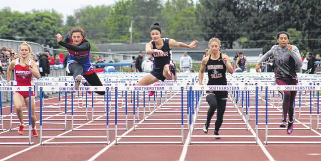 Northwest senior Haidyn Wamsley (second from left) and Wheelersburg senior Lauren Jolly (second from right) placed second and fourth respectively in the girls 100m hurdles finals from Saturday's Division II Region 7 track and field meet.