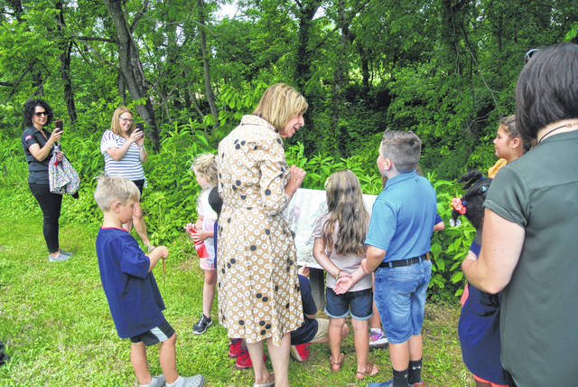 First Lady Fran DeWine walked with kids from the Shawnee State University Children's Learning Center at the newest Storybook Trail at Shawnee State Park on Friday.