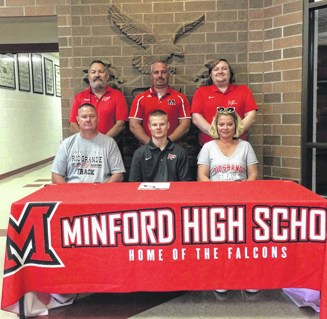 Minford High School graduate Drew Skaggs, seated center, announces his intention to run track and field for the University of Rio Grande. Seated with Skaggs are father Todd Skaggs (left) and mother Michelle Skaggs (right). Standing are, from left, University of Rio Grande assistant track and field coach Glen Queen, Minford High School boys track and field head coach Jesse Ruby and University of Rio Grande assistant track and field coach Jordan Cunningham.