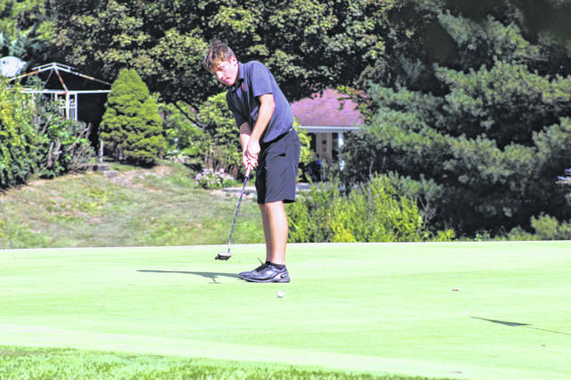Portsmouth West's Eli Adkins attempts a putt at The Elks Country Club in McDermott during a round in his junior season.