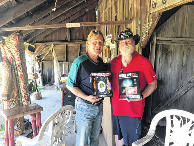 """Mike Brumfield (left) and Carl Durmsa (right) met at an UFO convention is Pasadena, California in 2018 and have stayed in touch as Brumfield wrote his latest book, """"Damned Angels."""" Brumfield will be signing copies on Saturday starting at 3 p.m. at Tracy Park."""