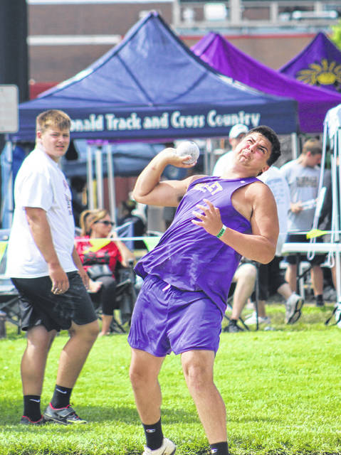 Valley High School sophomore Justin Moore competes on Friday in the Division III boys state shot put event.