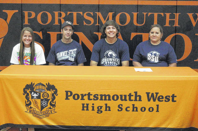 Portsmouth West senior Rodney Moore (right center) signed to continue his education and join the baseball team at Shawnee State University.