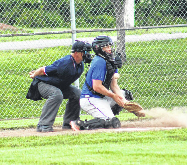 Portsmouth Post 23 Juniors catcher Jakob Tipton blocks a ball during the Blue Jays' baseball game with Wellston on Tuesday at Wellston's Veterans' Field.