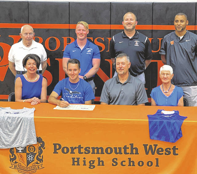 Portsmouth West senior Rhett Estep (left center seated) signed to join the men's track team at Alice Lloyd College at a signing ceremony in early July. Pictured: (Front row, L-R) Tiffany Estep, Rhett Estep, Lance Estep, Molly Humphrey; (Back row, L-R) John Humphrey, John Driskill, Todd Gilliland, Dell Peterson.