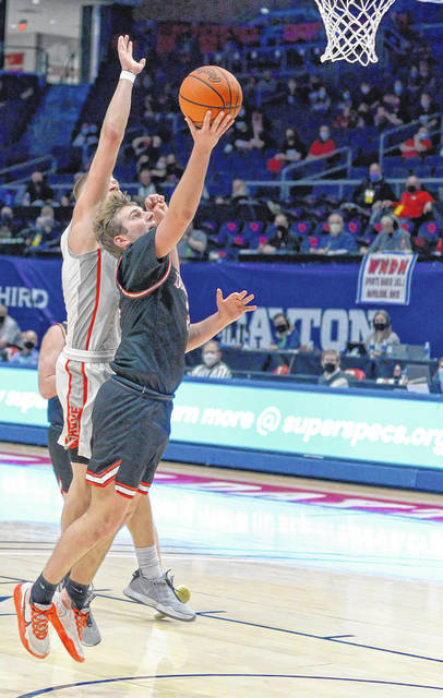 New Boston senior Tanner Voiers (3) attempts a layup during the Tigers' meeting with Columbus Grove in the boys Division IV state tournament in March.
