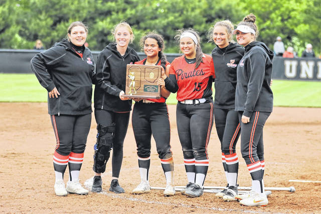 Wheelersburg senior softball players (L-R) Bayleigh Stevens, Laney Eller, Boo Sturgill, Rylie Hughes, Jaiden Missler and Payton Walker accept the Division III regional championship trophy following their 9-1 win over Ironton at Unioto High School.