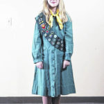 The trail of a Girl Scout Uniform