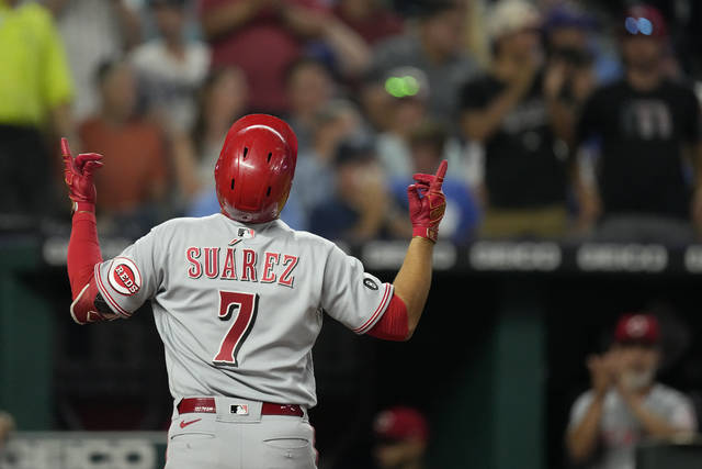 Cincinnati Reds' Eugenio Suarez celebrates after hitting a three-run home run during the seventh inning of a baseball game against the Kansas City Royals Monday, July 5, 2021, in Kansas City, Mo. (AP Photo/Charlie Riedel)