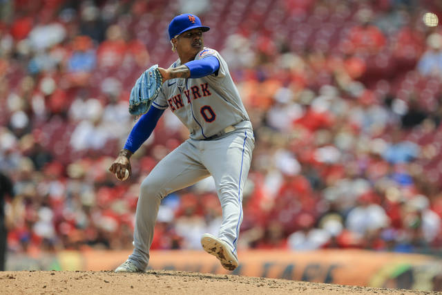 New York Mets' Marcus Stroman throws during the seventh inning of a baseball game against the Cincinnati Reds in Cincinnati, Wednesday, July 21, 2021. (AP Photo/Aaron Doster)