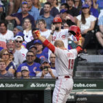 Votto hits 2 more homers as Reds roll past Cubs 7-4