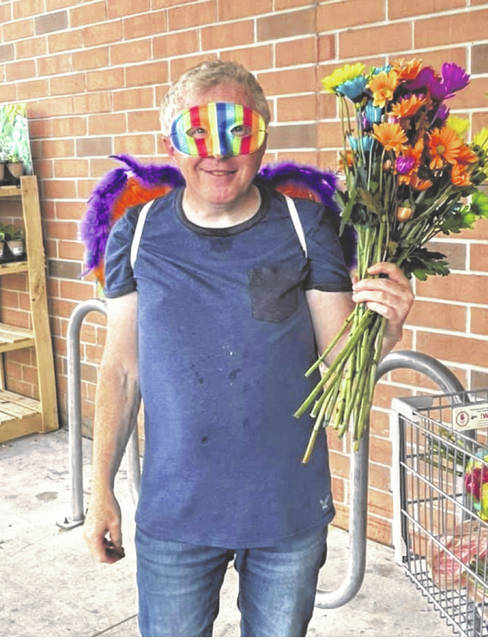 Chris Cooley spent four hours at the Portsmouth Kroger, in the hot sun passing out flowers to others.