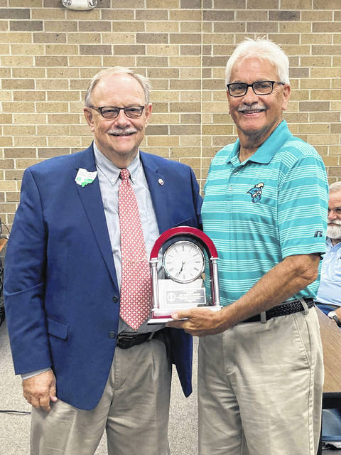 Dr. Timothy Horner (right) receiving his award for 40 years of service on the Bloom-Vernon School Board.