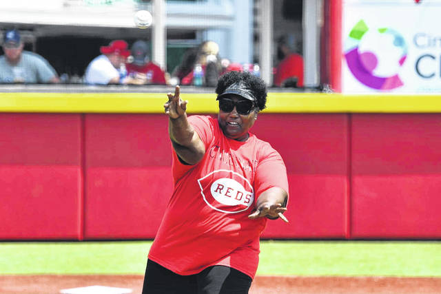 Maxine Malone, Director of the 14th Street Community Center, delivered the first pitch ahead of Sunday's Major League Baseball game between the Cincinnati Reds and Milwaukee Brewers.